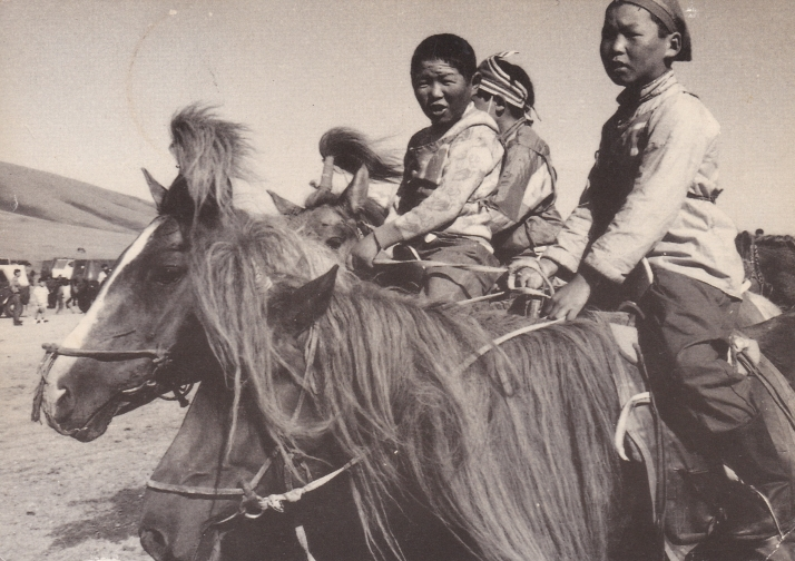 Mongolian children on horseback
