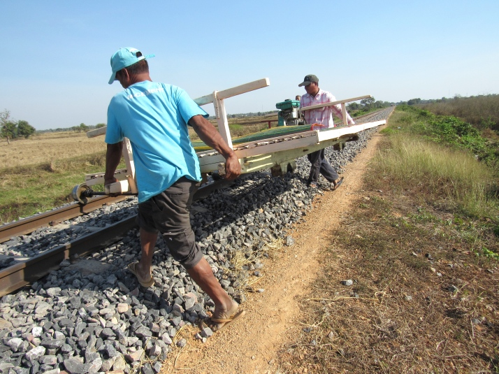 Lifting the bamboo train onto the track