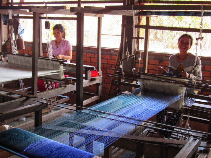 Women weaving silk