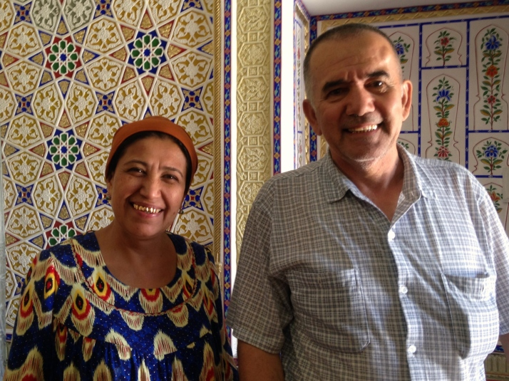 Sharif and his wife in their home with decorated walls